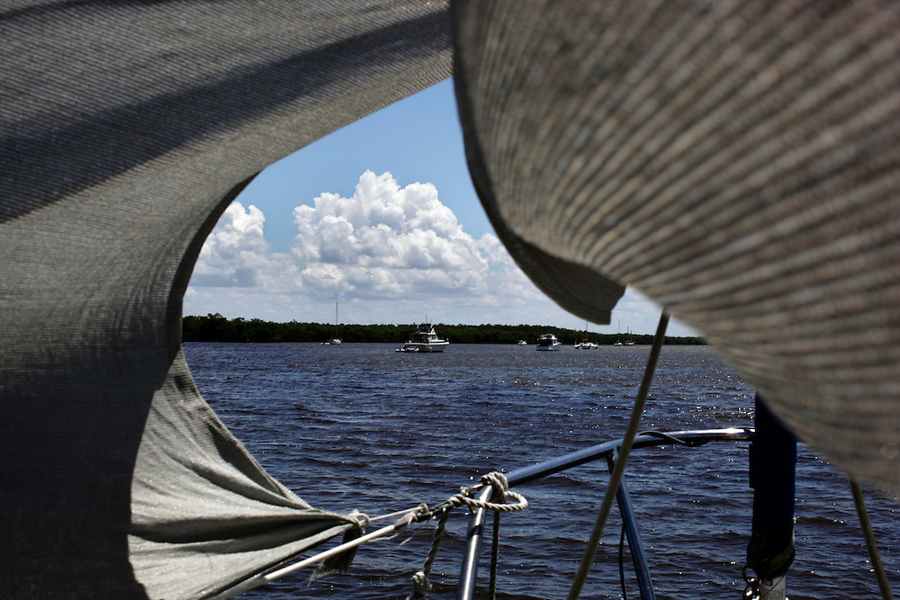 Anchored boats used as homes in Estero Bay are seen from Gerry Raccuia's sailboat a few hundred yards away.