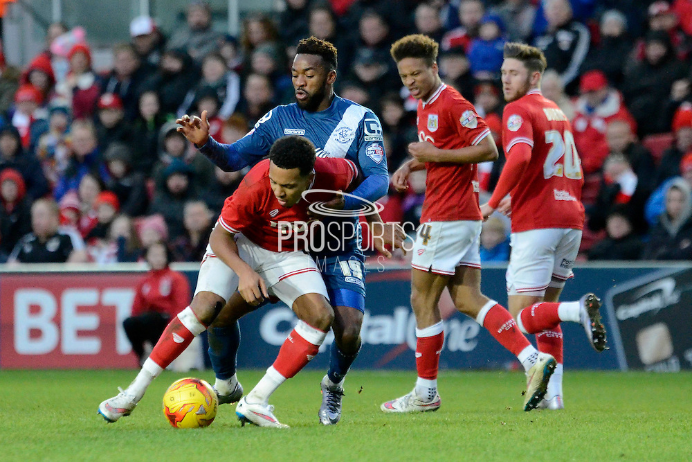 Birmingham City midfielder Jacques Maghoma and Bristol City midfielder Korey Smith battle for the ball during the Sky Bet Championship match between Bristol City and Birmingham City at Ashton Gate, Bristol, England on 30 January 2016. Photo by Alan Franklin.