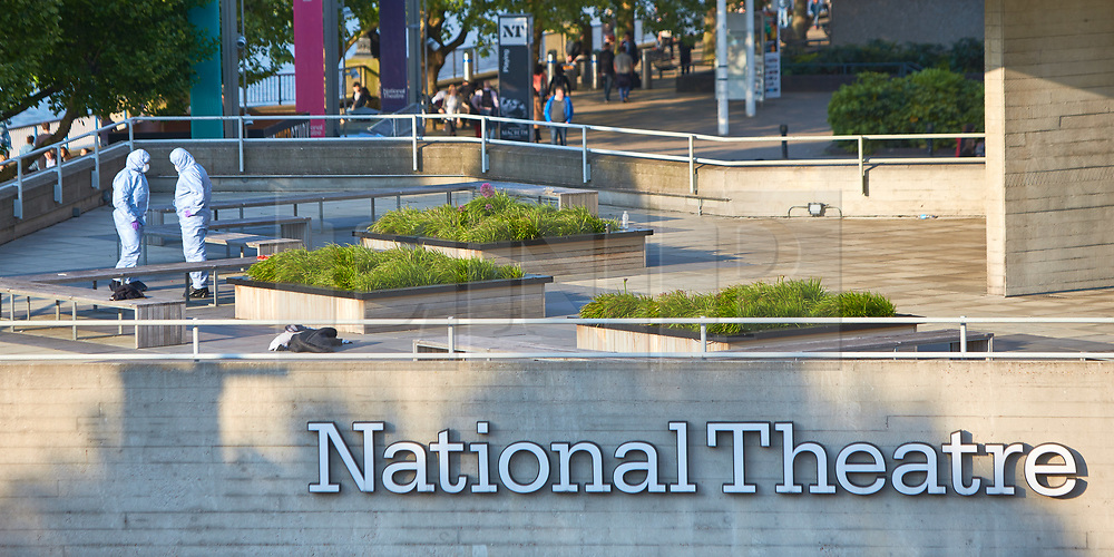 © Licensed to London News Pictures. 13/05/2018. LONDON, UK.  Forensic officers examine in the scene outside the National Theatre on London's Southbank where a man was stabbed at 4pm this afternoon. The annual BAFTA awards are being held just yards away. .  Photo credit: Cliff Hide/LNP