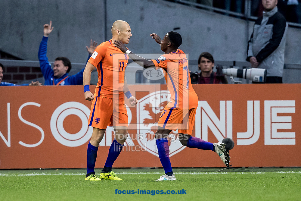 Arjen Robben of Netherlands (L) has scored 2-0, Quincy Promes of Netherlands (R) during the 2018 FIFA World Cup Qualifying match at Amsterdam Arena, Amsterdam<br /> Picture by Joep Joseph Leenen/Focus Images Ltd +316 5261929<br /> 03/09/2017<br /> ***NETHERLANDS OUT***