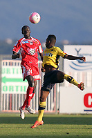 Sochaux's forward Sloan Privat vies with Ajaccio's defender Fousseni Diawara  during the french L1 football match Ajaccio vs. Sochaux at the Francois Coty stadium in Ajaccio, Corsica, on May 2, 2012. PHOTO PASCAL POCHARD-CASABIANCA / AFP / DPPI