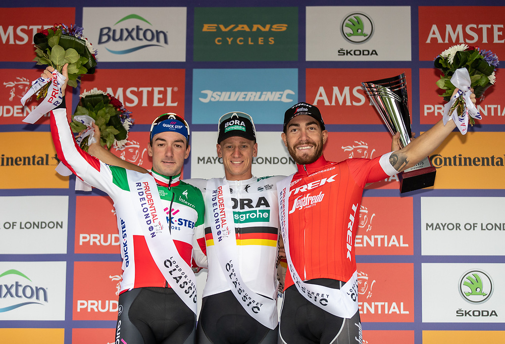 From left to right, Elia Viviani of Quick-Step Floors second place, Pascal Akermann of Bora-Hansgrohe first place and Giacomo Nizzolo of Trek-Segafredo third place in The Prudential Ride London Classic. Sunday 29th July 2018<br /> <br /> Photo: Ian Walton for Prudential RideLondon<br /> <br /> Prudential RideLondon is the world's greatest festival of cycling, involving 100,000+ cyclists - from Olympic champions to a free family fun ride - riding in events over closed roads in London and Surrey over the weekend of 28th and 29th July 2018<br /> <br /> See www.PrudentialRideLondon.co.uk for more.<br /> <br /> For further information: media@londonmarathonevents.co.uk