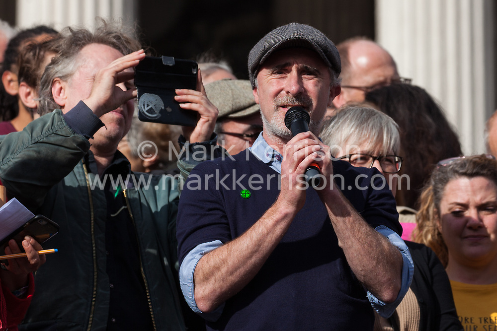 London, UK. 16 October, 2019. Marc Lopatin of Extinction Rebellion addresses hundreds of fellow climate activists defying the Metropolitan Police prohibition on Extinction Rebellion Autumn Uprising protests throughout London under Section 14 of the Public Order Act 1986 by attending a Right to Protest assembly in Trafalgar Square.