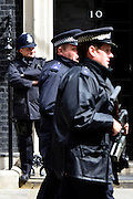 © Licensed to London News Pictures. 23/05/2013. London, UK Security outside number ten today. David Cameron, Conservative MP, British Prime Minister makes a statement after a meeting of COBRA (Cabinet Office Briefing Room A) to discuss yesterday's alleged terrorist attack in Woolwich. Photo credit : Stephen Simpson/LNP