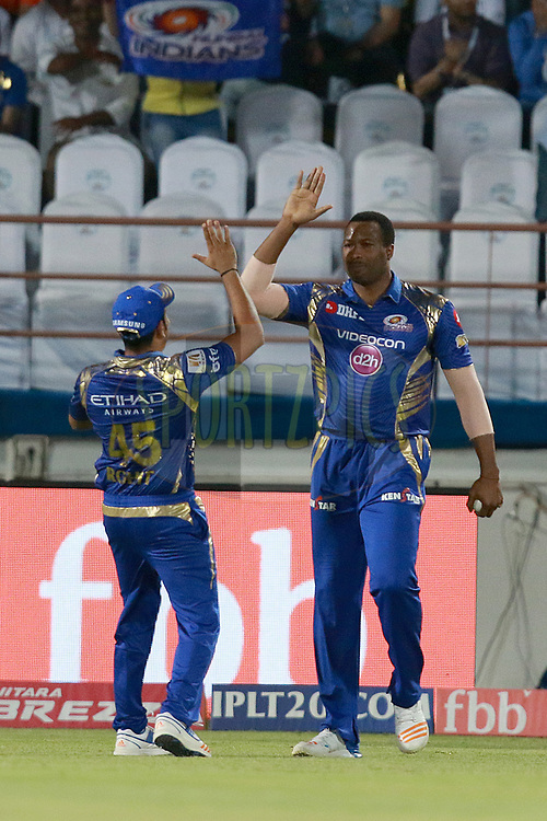 Kieron Pollard of MI celebartes after takes a catch of Suresh Raina captain of GL during match 35 of the Vivo 2017 Indian Premier League between the Gujarat Lions and the Mumbai Indians  held at the Saurashtra Cricket Association Stadium in Rajkot, India on the 29th April 2017<br /> <br /> Photo by Rahul Gulati - Sportzpics - IPL