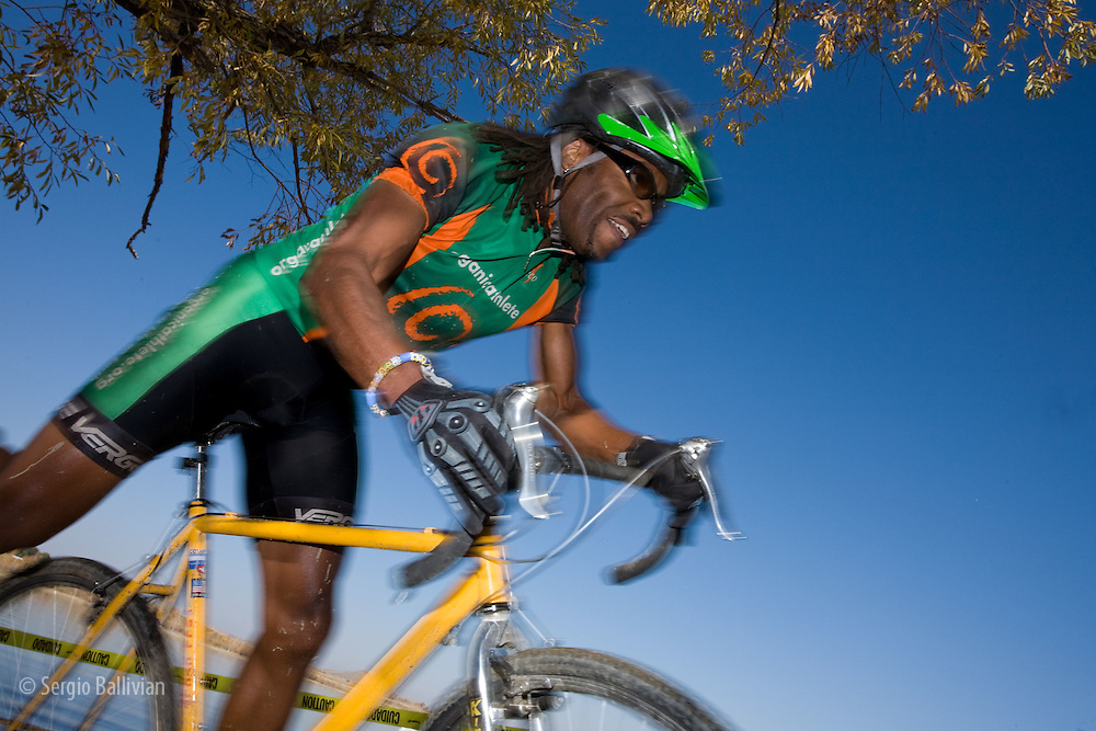 Cyclecross racers riding hard as they negotiate obstacles on a course in Boulder, Colorado in early winter.