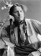 Samuel American Horse, Native American Indian,  probably a member of Buffalo Bill's Wild West Show. Photographic half-length portrait facing front, wearing native dress, c1900.