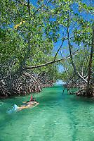 Girl snorkeling at Caracoles cay