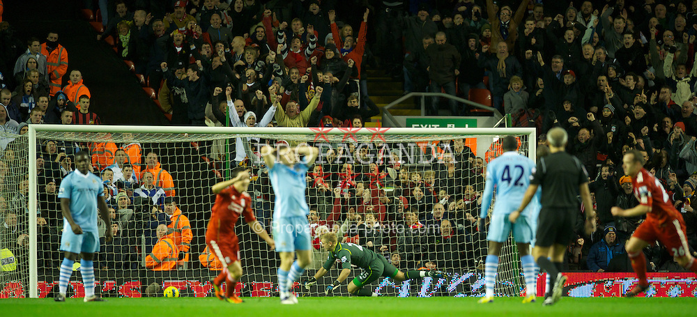 LIVERPOOL, ENGLAND - Sunday, November 27, 2011: Manchester City's goalkeeper Joe Hart looks dejected as Liverpool's Charlie Adam scores the equalising 1-1 goal, after a massive deflection by Joleon Lescott, during the Premiership match at Anfield. (Pic by David Rawcliffe/Propaganda)