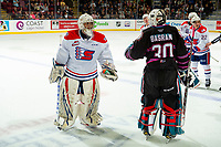KELOWNA, BC - SEPTEMBER 21:  Roman Basran #30 of the Kelowna Rockets stands on the ice and speaks to Campbell Arnold #1 of the Spokane Chiefs  at Prospera Place on September 21, 2019 in Kelowna, Canada. (Photo by Marissa Baecker/Shoot the Breeze)