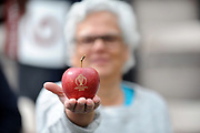 An ICC Branded apple held out by a spectator during the ICC Cricket World Cup 2019 match between England and West Indies at the Hampshire Bowl, Southampton, United Kingdom on 14 June 2019.