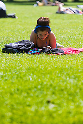 Green Park, London, June 6th 2016. A woman sunbathes in Green Park as London basks in glorious summer sunshine with highs of 24º expected.