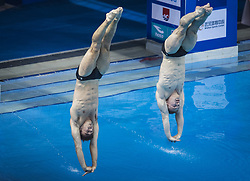June 5, 2018 - Wuhan, China - CHRIS MEARS and JACK LAUGHER (R) of Britain compete during the men's 3m springboard synchronised final at the FINA Diving World Cup 2018 in Wuhan, central China's Hubei Province. Chris Mears/Jack Laugher took the second place with a total of 440.64 points. (Credit Image: © Xiao Yijiu/Xinhua via ZUMA Wire)