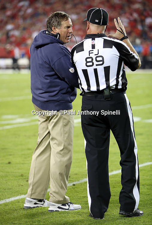 New England Patriots head coach Bill Belichick talks to field judge Jon Lucivansky (89) during the NFL week 4 regular season football game against the Kansas City Chiefs on Monday, September 29, 2014 in Kansas City, Mo. The Chiefs won the game 41-14. ©Paul Anthony Spinelli