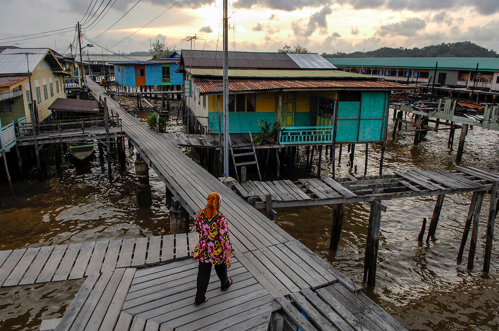 Life in the kampong ayer, or water village, is the norm for generations of Bruneians. Though this is under threat from pressures on safety and globalised thinking. Bandar Seri Begawan, Brunei Darussalam