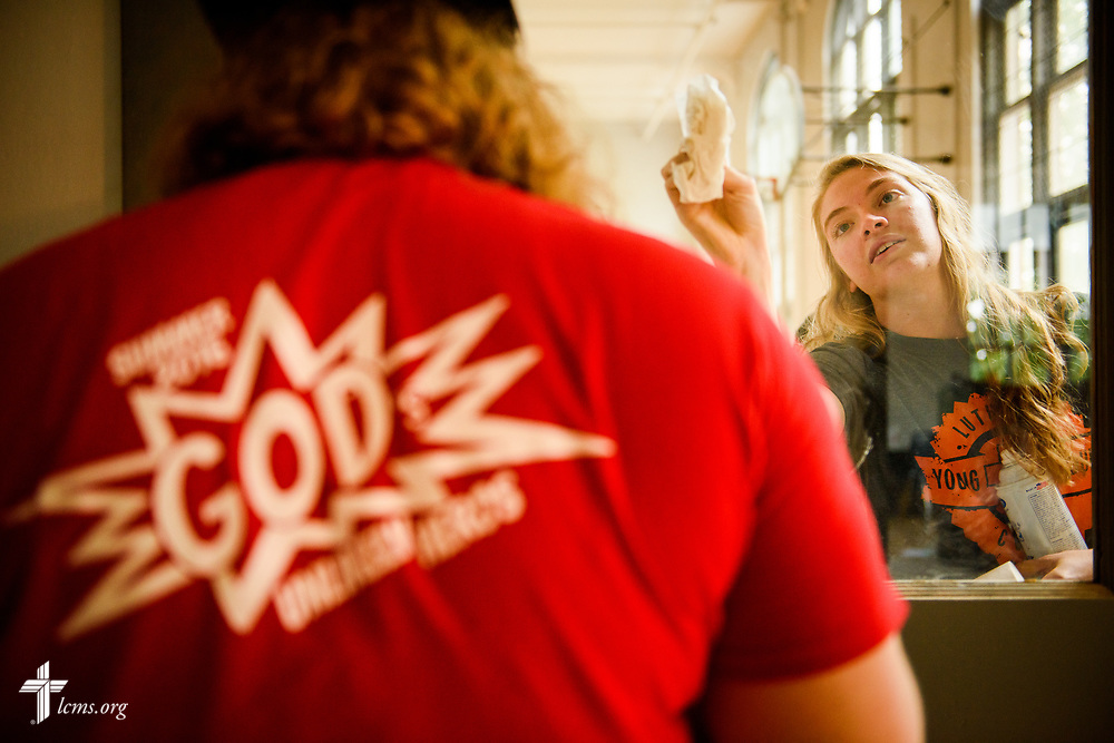 Megan Barz of Lutheran Young Adult Corps cleans windows as she serves with fellow volunteers on Thursday, Aug. 10, 2017, at Eagle College Prep in south St. Louis. LCMS Communications/Erik M. Lunsford