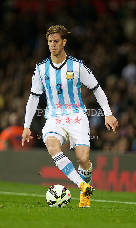 MANCHESTER, ENGLAND - Tuesday, November 18, 2014: Argentina's Cristian Ansaldi in action against Portugal during the International Friendly match at Old Trafford. (Pic by David Rawcliffe/Propaganda)