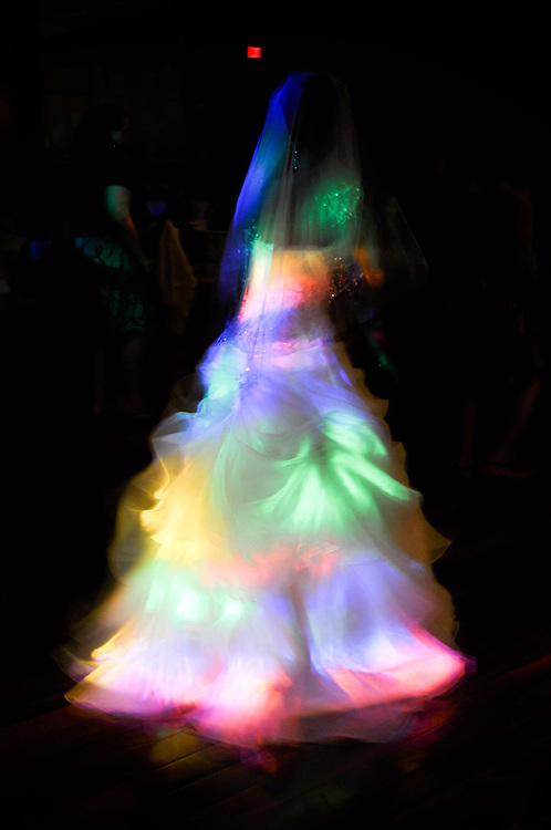 Cassie's gown illuminated in the dance floor disco lights