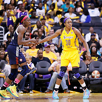 03 August 2014: Los Angeles Sparks forward Nneka Ogwumike (30) defends on Connecticut Sun forward Chiney Ogwumike (13) during the Los Angeles Sparks 70-69 victory over the Connecticut Sun, at the Staples Center, Los Angeles, California, USA.