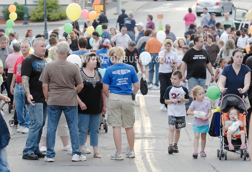 Middletown, New York - People attend the Night Out Against Crime event on West Main Street on Tuesday, Aug. 3, 2010.©Tom Bushey / The Image Works