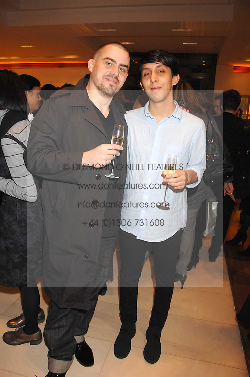 Left to right, MARCOS VILLALBA and CHRISTOPHER LAWSON designers of the 2007 LV windows at a reception to launch the 2007 Louis Vuitton Christmas windows in collaboration with Central Saint Martins College of Art & Design held at 17-18 New Bond Street, London W1 on 7th November 2007.<br /><br />NON EXCLUSIVE - WORLD RIGHTS