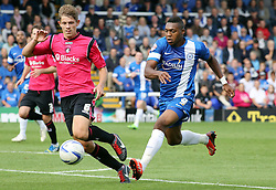 Peterborough United's Britt Assombalonga in action with Oldham Athletic's James Tarkowski  - Photo mandatory by-line: Joe Dent/JMP - Tel: Mobile: 07966 386802 17/08/2013 - SPORT - FOOTBALL - London Road Stadium - Peterborough -  Peterborough United V Oldham Athletic - Sky Bet League One