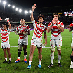 Japan celebrate after winning the Rugby World Cup match between Japan and Scotland at International Stadium Yokohama on October 13, 2019 in Yokohama, Japan. (Photo by Dave Winter/Icon Sport) - --- - International Stadium Yokohama - Yokohama (Japon)