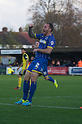 Barry Fuller celebrates hi opener during the Sky Bet League 2 match between AFC Wimbledon and Dagenham and Redbridge at the Cherry Red Records Stadium, Kingston, England on 15 November 2014.