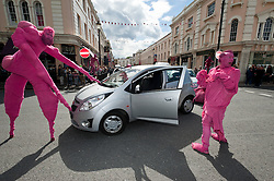 "© Licensed to London News Pictures. 24/06/2012. London, UK.  Aliens land in Greenwich and stop traffic.  ""The Invasion"" is a Slovenian street theatre act comprising of pink aliens which roam around Greenwich as part of Greenwich Fair.  Greenwich Fair is a part of the Greenwich & Docklands International Festival, taking place between 21-30 June.  Photo credit : Richard Isaac/LNP"