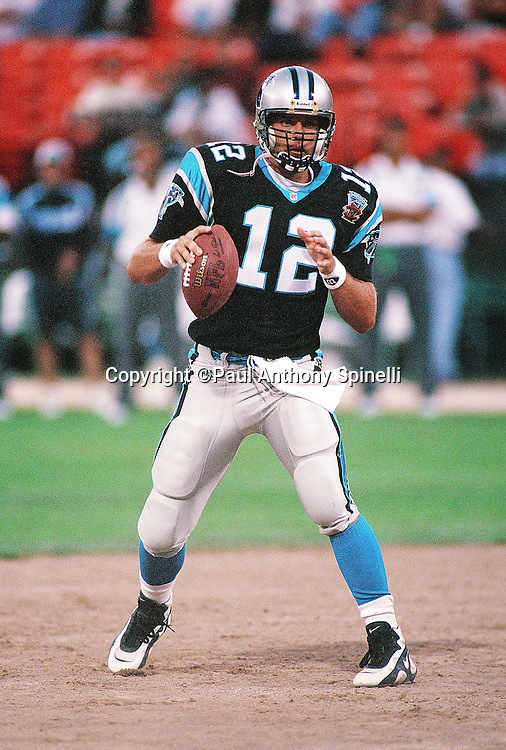 Carolina Panthers quarterback Kerry Collins (12) drops back to pass during the NFL preseason football game against the San Francisco 49ers on Aug. 19, 1995 in San Francisco. The 49ers won the game 17-10. (©Paul Anthony Spinelli)