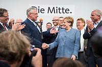 24 SEP 2017, BERLIN/GERMANY:<br /> Joachim Herrmann (Mi-L), CSU, Innenminister Bayern, und Angela Merkel (Mi-R), CDU, Bundeskanzlerin, geben sich die Hand, Wahlparty in der Wahlnacht, Bundestagswahl 2017, Konrad-Adenauer-Haus, CDU Bundesgeschaeftsstelle<br /> IMAGE: 20170924-01-099<br /> KEYWORDS: Election Party, Election Night, Haende, H&auml;nde, Handshake, Handschlag