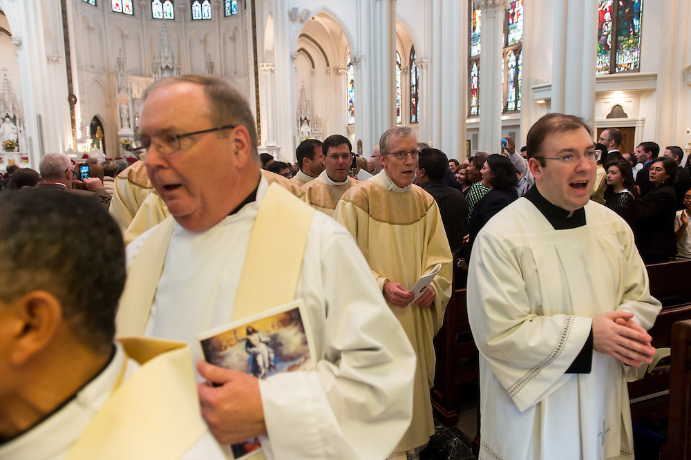 DENVER, CO - MAY 16: John Miller (R) and Msgr. Bernie Schmitz (2nd-R) process out of the Cathedral Priest Ordination for the Archdiocese of Denver at the Cathedral Basilica of the Immaculate Conception on May 16, 2015, in Denver, Colorado. (Photo by Daniel Petty/Denver Catholic Register)