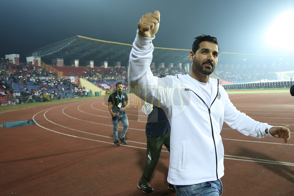 NorthEast United FC coowner John cheering up fans during match 19 of the Hero Indian Super League between NorthEast United FC and Bengaluru FC held at the Indira Gandhi Athletic Stadium, Guwahati India on the 8th December 2017<br /> <br /> Photo by: Saikat Das  / ISL / SPORTZPICS