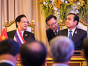 23 JULY 2015 - BANGKOK, THAILAND: NGUYEN TAN DUNG (left), Prime Minister of Vietnam,  and PRAYUTH CHAN-O-CHA, Prime Minister of Thailand, (right) at a ceremony for signing bilateral agreements between Thailand and Vietnam at Government House in Bangkok. The Vietnamese Prime Minister and his wife came to Bangkok for the 3rd Thailand - Vietnam Joint Cabinet Retreat. The Thai and Vietnamese Prime Minister discussed issues of mutual interest.      PHOTO BY JACK KURTZ