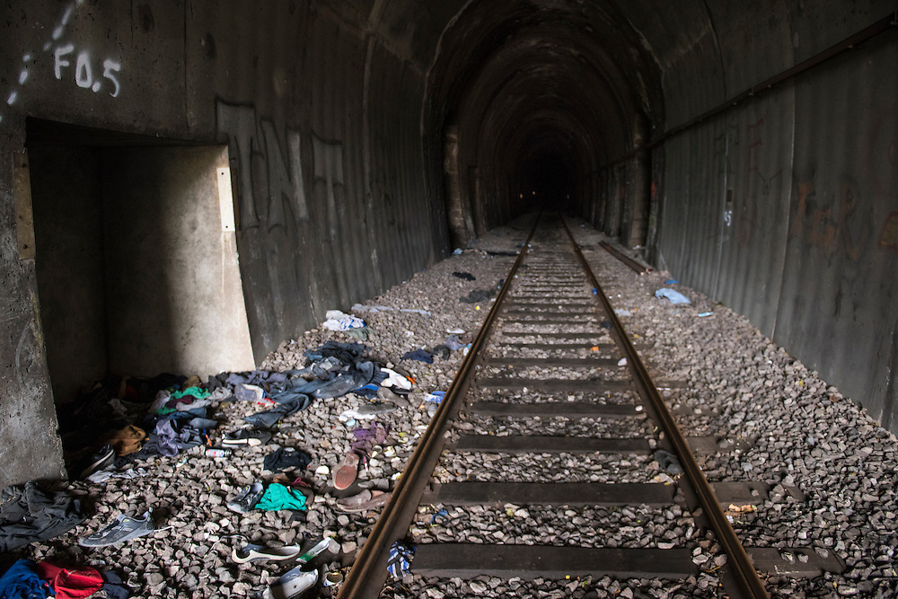 December 5, 2016 - Breil-sur-Roya, France: Discarded clothing and shoes testify to the passage of migrants through a train tunnel from Italy to France. <br /> <br /> 5 d&eacute;cembre 2016 - Breil-sur-Roya, France: Des v&ecirc;tements et des chaussures jet&eacute;s t&eacute;moignent du passage de migrants dans un tunnel ferroviaire d'Italie vers la France.