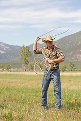 hot cowboy out on a ranch roping