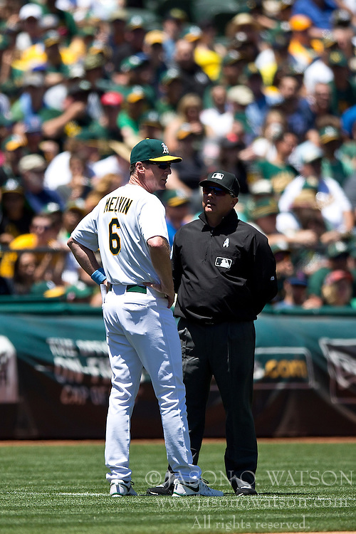 OAKLAND, CA - JUNE 21:  Bob Melvin #6 of the Oakland Athletics argues with umpire Greg Gibson #53 after Brett Lawrie (not pictured) was called out attempting to steal third base against the Los Angeles Angels of Anaheim during the second inning at O.co Coliseum on June 21, 2015 in Oakland, California. (Photo by Jason O. Watson/Getty Images) *** Local Caption *** Bob Melvin; Greg Gibson