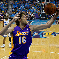April 28, 2011; New Orleans, LA, USA; Los Angeles Lakers power forward Pau Gasol (16) grabs a rebound over teammate center Andrew Bynum (17)  during the first quarter in game six of the first round of the 2011 NBA playoffs against the New Orleans Hornets at the New Orleans Arena. The Lakers defeated the Hornets 98-80 to advance to the second round of the playoffs.   Mandatory Credit: Derick E. Hingle