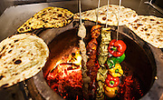 Assorted food in a tandoor oven in an Indian restaurant.