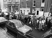 Irish Nurses Organisation Protest..28.05.1986..05.28.1986..28th May 1986..In protest against proposed health cuts the Irish Nurses Organisation organised a protest march to Dail Eireann. Nurses from all over Ireland were represented at the march...Photograph shows  the nurses progress towards Leinster House. The banners show that nurses travelled from all around the country to take part.