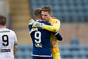 14th September 2019; Dens Park, Dundee, Scotland; Scottish Championship, Dundee Football Club versus Alloa Athletic; A hug from Andrew Nelson at full time for goalkeeper Jack Hamilton of Dundee who saved a penalty as Dundee beat Alloa