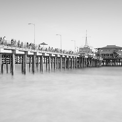 Santa Monica Pier black and white panorama photo. Santa Monica is a coastal beach city along the Pacific Ocean in Los Angeles County California. Panoramic photo ratio is 1;3. Copyright ⓒ 2017 Paul Velgos with All Rights Reserved.