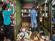 04 JANUARY 2016 - BANGKOK, THAILAND:        Workers take apart a closed shop in Bang Chak Market after the market closed permanently. The market closed January 4, 2016. The Bang Chak Market serves the community around Sois 91-97 on Sukhumvit Road in the Bangkok suburbs. About half of the market has been torn down. Bangkok city authorities put up notices in late November that the market would be closed by January 1, 2016 and redevelopment would start shortly after that. Market vendors said condominiums are being built on the land.       PHOTO BY JACK KURTZ