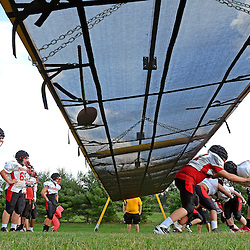 Staff photos by Tom Kelly IV<br /> Linemen drills during Penncrest football practice on Tuesday August 26, 2014.