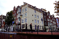Tall narrow houses along the canals of Amsterdam.