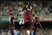 BRISBANE, AUSTRALIA - FEBRUARY 13:  Darren Sammy of the West Indies celebrates a wicket off his first delivery during the International Twenty20 match between Australia and the West Indies at The Gabba on February 13, 2013 in Brisbane, Australia.  (Photo by Matt Roberts/Getty Images)