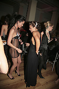 Jasmine Lennard and Amber Nuttall, Andy and Patti Wong's Chinese New Year of the Pig party. Madame Tussauds. ( Dress Burlesque, Debauched or Hollywood Black Tie. ) London. 27 January 2007.  -DO NOT ARCHIVE-© Copyright Photograph by Dafydd Jones. 248 Clapham Rd. London SW9 0PZ. Tel 0207 820 0771. www.dafjones.com.