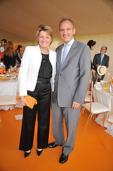 CECILE BONNEFOND President Veuve Clicquot Ponsardin and GRAHAM BOYES MD of Veuve Clicquot   at the 2009 Veuve Clicquot Gold Cup Polo final at Cowdray Park Polo Club, Midhurst, West Sussex on 19th July 2009.