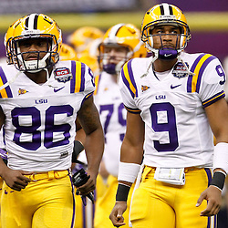 Jan 9, 2012; New Orleans, LA, USA; LSU Tigers quarterback Jordan Jefferson (9) looks on as he runs out with teammates before the 2012 BCS National Championship game against the Alabama Crimson Tide at the Mercedes-Benz Superdome.  Mandatory Credit: Derick E. Hingle-US PRESSWIRE