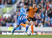 Joao Carlos Teixeira, Brighton midfielder and Kevin McDonald during the Sky Bet Championship match between Brighton and Hove Albion and Wolverhampton Wanderers at the American Express Community Stadium, Brighton and Hove, England on 14 March 2015.